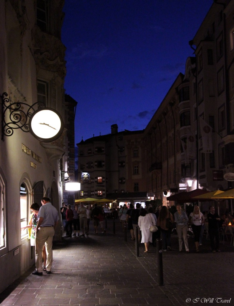 The streets of Innsbruck at dusk full of residents and visitors