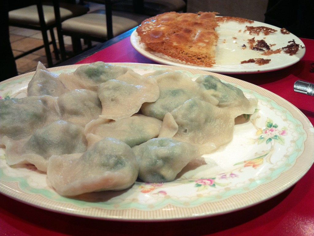 A plate of spinach and mushrooms dumplings