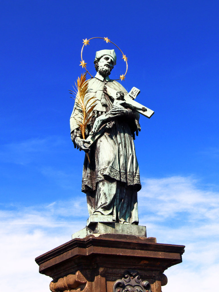 The statue of John of Nepomuk on the north side of  Charles Bridge