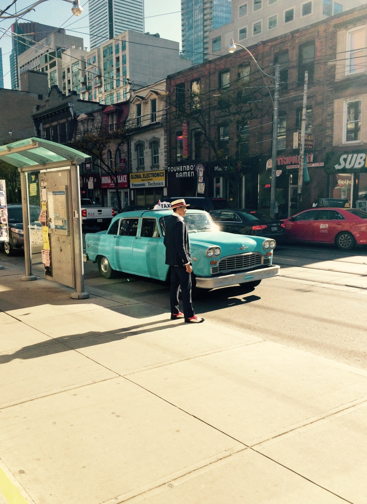 El Taxi Loco parked on a street in downtown Toronto