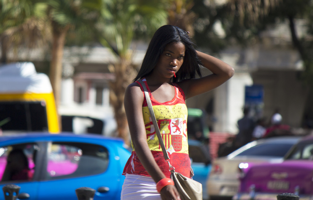 A girl walking in Havana on a hot and sunny day.