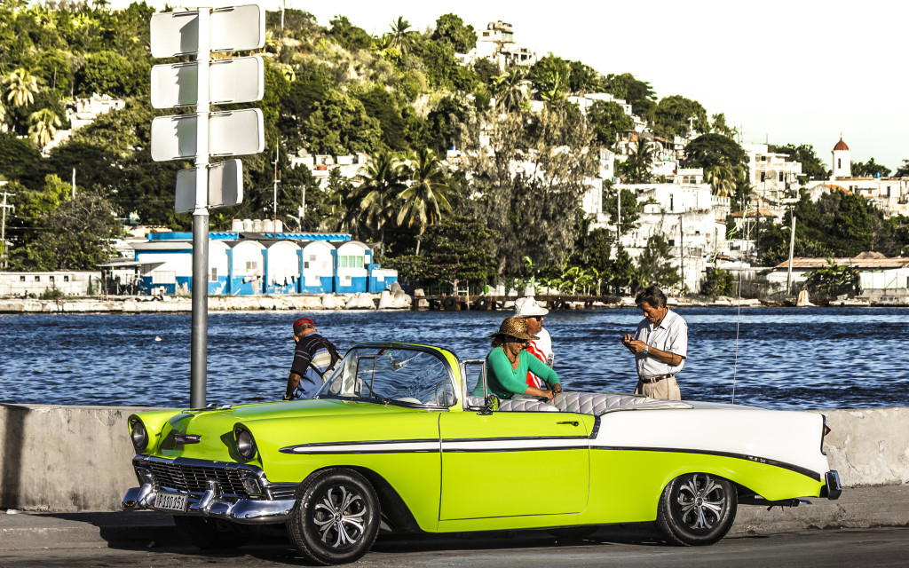 An classic lime-green oldtimer, parked on the malecon.