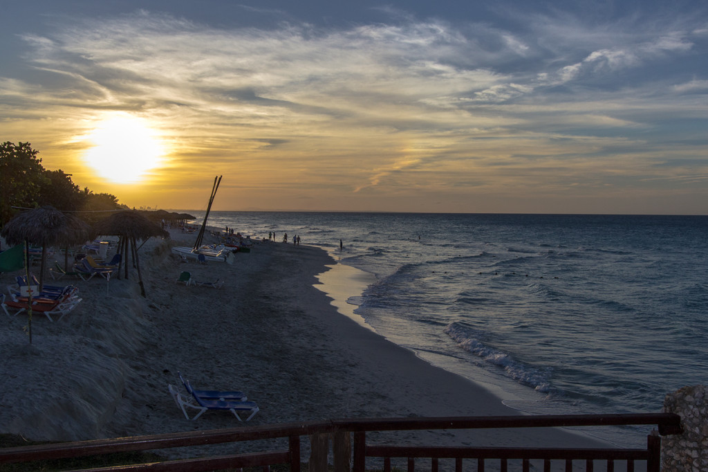 View of the beach and sunset from the beach bar restaurant