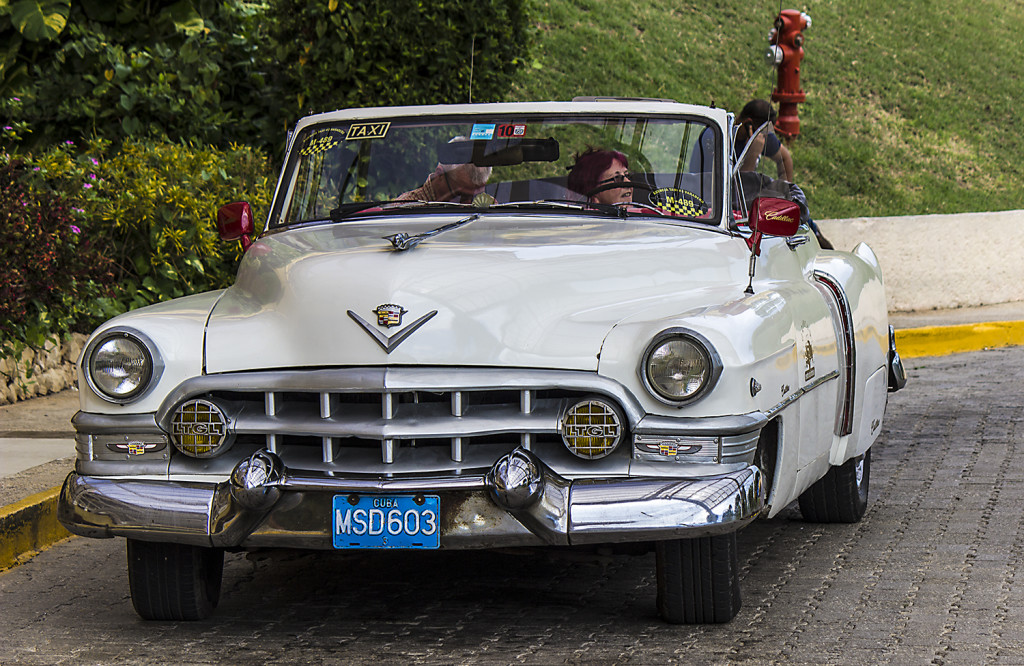 An oldtimer parked outside the lobby of the Breezes Bella Costa resort.
