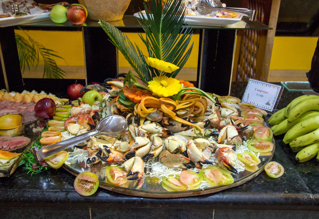 A seafood platter with crab legs and claws