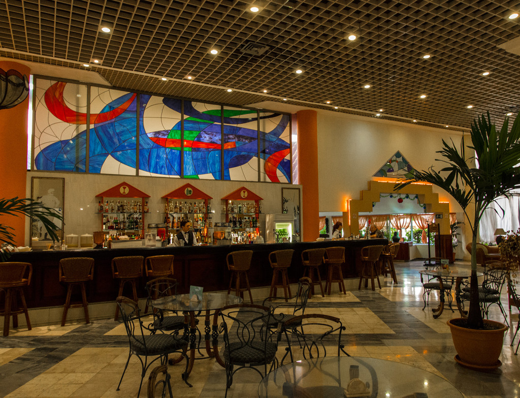 The lobby bar of Breezes Bella Costa