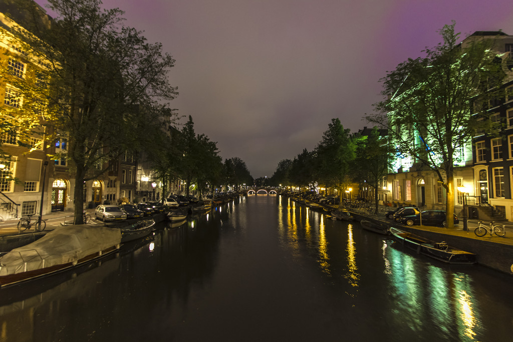 A night photo of one of the canals in Amsterdam
