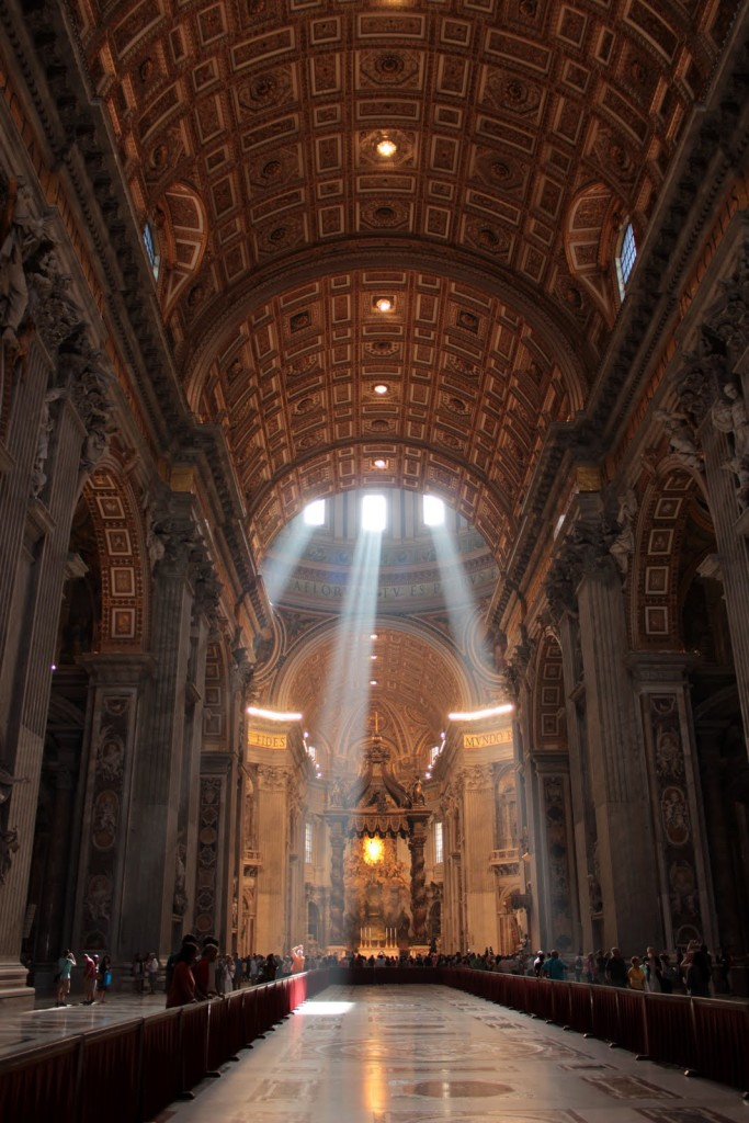 A photo showing the rays of sun beaming down inside Saint Peter's Basillica
