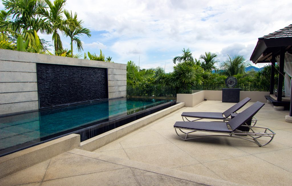 Deck and swimming pool at one of the private villas in thePavilions Phuket